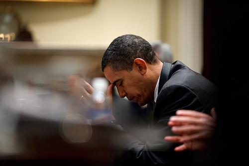 President Obama prays.