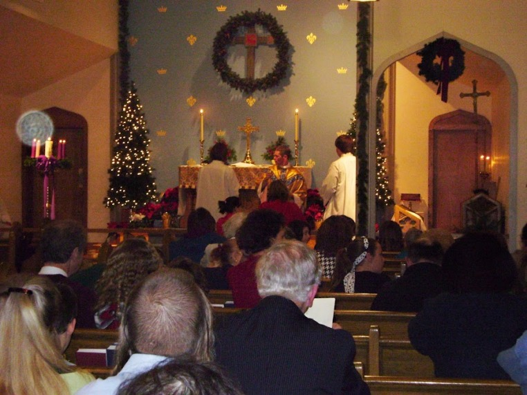 Parishioners of Anglican Church of the Good Shepherd celebrate Christmas just prior to vacating their 130-year old church building. (Photo: Matt Kennedy)