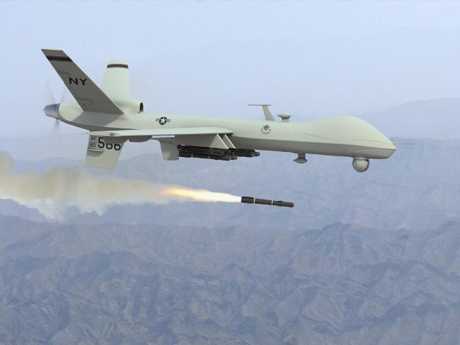 Drone Predator firing missile