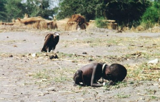 (Photo credit: Kevin Carter, 1960-1994) This famous picture was taken in March 1993 outside an emergency  feeding center in Ayod, South Sudan. Carter committed suicide in July 1994, just months after winning the Pulitzer Prize for the photo.