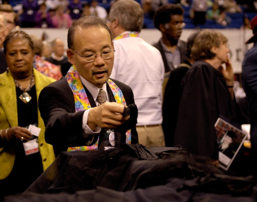Bishop Robert Hoshibata was one of the Western Jurisdiction bishops who occupied the floor and draped the altar in black cloth to protest the 2008 General Conference's affirmation of the church's affirmation of biblical standards for sexual self-control. He now leads the Desert-Southwest Conference, which has several times fewer members than many other annual conferences. (Photo credit: United Methodist News Service)
