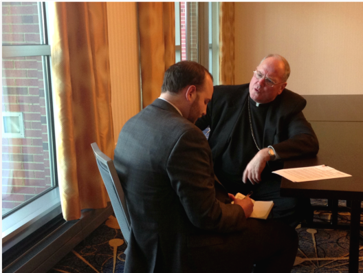 The author interviewing His Eminence, Timothy Cardinal Dolan (Photo Credit: Colson Center)