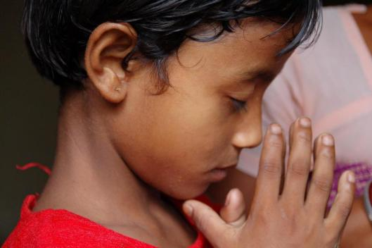 Indian child praying