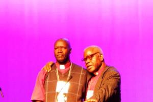 The two Bishop Nathans: Bishop Nathan Inyom prays for Bishop Nathan Gasatura and for Rwanda.