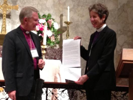 Church of Sweden Archbishop Anders Werjyd and Episcopal Church Presiding Bishop Katharine Jefferts Schori present their signed climate change statement at St. John's Episcopal Church in Washington, D.C. on May 1.