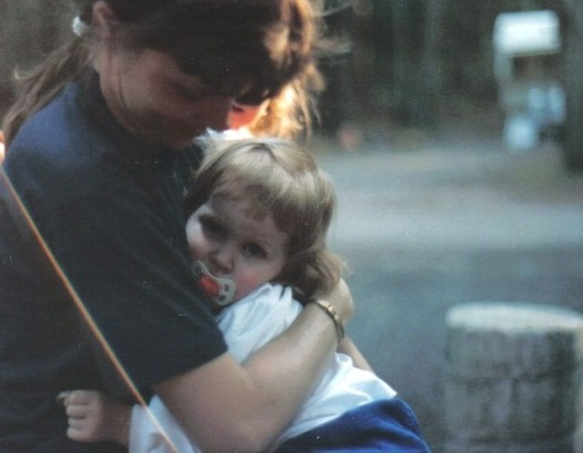 Mom comforting a two year old me after a taking a tumble.