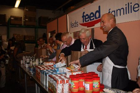 Congressman Frank Wolf helping Feds Feed Families,  (Photo credit: wolf.house.gov)