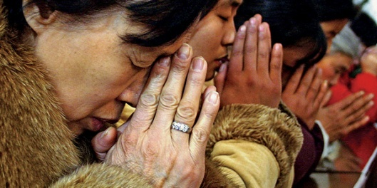 Christians pray in one of China's underground churches (Photo credit: Alpha Relief)