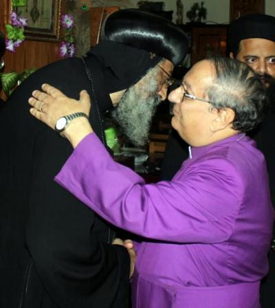 Anglican Bishop of Egypt Mouneer Anis (R) greets Coptic Pope Tawadros II (Photo credit: Coptic Orthodox Church of Alexandria).