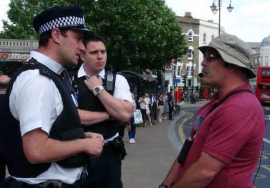 "American evangelist Tony Miano was arrested for preaching against sexual immorality and was found to be in violation of Public Order Act Section 5, for ""using homophobic speech"" in downtown Wimbledon, London, England, July 1, 2013. (Photo credit: Screengrab/YouTube.com)"